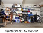 Suburban garage mess.  Boxes, tools and toys in disarray. - stock photo