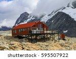 mueller alpine hut and mountain ... | Shutterstock . vector #595507922