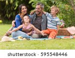 cheerful family sitting on the...   Shutterstock . vector #595548446