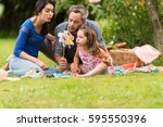 cheerful family sitting on the... | Shutterstock . vector #595550396