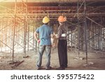 two business man construction... | Shutterstock . vector #595575422