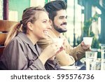 young couple is enjoying coffee ... | Shutterstock . vector #595576736