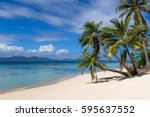 a few coconut trees providing... | Shutterstock . vector #595637552