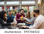 friends are hanging out in a... | Shutterstock . vector #595706522