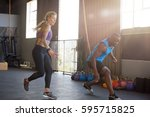 man and woman sprinting in gym... | Shutterstock . vector #595715825