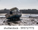boat at low tide in the saint... | Shutterstock . vector #595717772