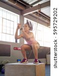 woman doing box jumps in gym ... | Shutterstock . vector #595729202