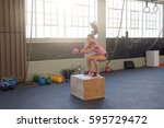 young fit woman doing box jumps ... | Shutterstock . vector #595729472