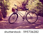 a bicycle on the road among the ... | Shutterstock . vector #595736282