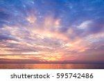 fiery backdrop over water  | Shutterstock . vector #595742486