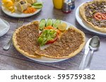 plate of traditional syrian... | Shutterstock . vector #595759382