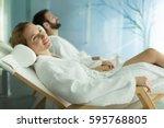 happy married couple relaxing... | Shutterstock . vector #595768805