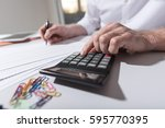 male hand using calculator ... | Shutterstock . vector #595770395