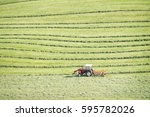 Haymaking On A Hillside With...