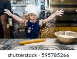 cooking. child prepare food in... | Shutterstock . vector #595785266