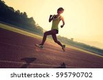 young fitness woman runner... | Shutterstock . vector #595790702