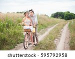 the guy and the girl standing... | Shutterstock . vector #595792958