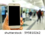 hand holding smartphone with... | Shutterstock . vector #595810262