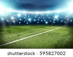 football pitch and blue lights  | Shutterstock . vector #595827002
