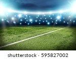football pitch and blue lights  | Shutterstock . vector #595827002