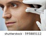 facial beauty treatment.... | Shutterstock . vector #595885112