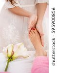 Hands Giving Foot Massage...