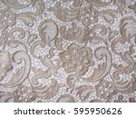 gold lace fabric. flowers. lace. | Shutterstock . vector #595950626