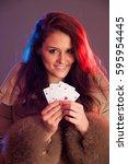beautiful brunette holding four ... | Shutterstock . vector #595954445