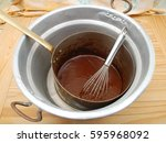 melted chocolate in a double... | Shutterstock . vector #595968092