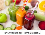 various freshly squeezed... | Shutterstock . vector #595985852