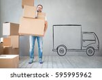 man carrying boxes into new... | Shutterstock . vector #595995962