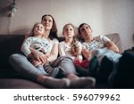 the family is sitting on the... | Shutterstock . vector #596079962