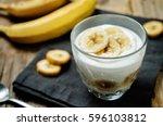 greek yogurt banana parfait on... | Shutterstock . vector #596103812