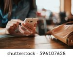 hand of woman using smartphone... | Shutterstock . vector #596107628