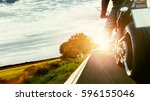motorbike on the road riding.... | Shutterstock . vector #596155046