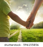 mother and son holding hand in... | Shutterstock . vector #596155856