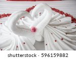 two swans and heart made from... | Shutterstock . vector #596159882