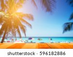 wood plank with blurred sea and ... | Shutterstock . vector #596182886