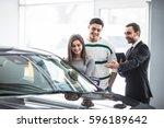 beautiful young couple choosing ... | Shutterstock . vector #596189642