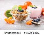 healthy breakfast   muesli ... | Shutterstock . vector #596251502