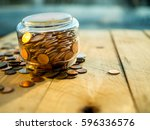 upside down the jar of coins on ... | Shutterstock . vector #596336576