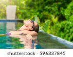 attractive young woman relaxing ...   Shutterstock . vector #596337845