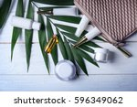 cosmetic bag with products and... | Shutterstock . vector #596349062