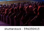 people in the auditorium... | Shutterstock . vector #596350415