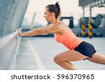 athletic woman stretching legs... | Shutterstock . vector #596370965