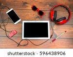 smart phone and headphones on... | Shutterstock . vector #596438906