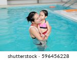 close up mother teaching kid in ... | Shutterstock . vector #596456228