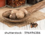 nutmeg in a wooden spoon on old ...   Shutterstock . vector #596496386