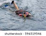young woman swimming underwater ...   Shutterstock . vector #596519546