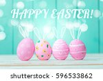 easter eggs on wooden background   Shutterstock . vector #596533862